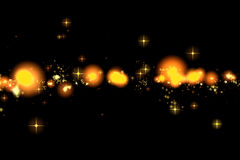 Gold glow glittering stars bokeh tail transition sparkle explosion effect on black background, holiday happy new year Royalty Free Stock Photography