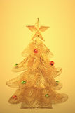 Gold, glowing christmas tree Stock Photography