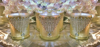 Gold goblets. Festive jewel decorated gold goblets stock photo