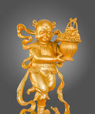 Gold God of Wealth or prosperity (Cai Shen) statue. Stock Images