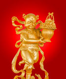 Gold God of Wealth or prosperity (Cai Shen) statue. Royalty Free Stock Images