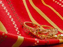 Gold on Gold--Rings and Bracelet Intertwined Stock Image