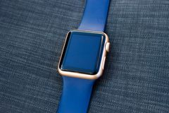 Gold golden blue smart watch turn off black screen close up Royalty Free Stock Photography