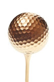 Gold golf ball Royalty Free Stock Photo
