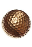 Gold golf ball Stock Images