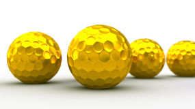 Gold golf balls. 3D rendering of gold golf balls. Shallow focus Stock Photo