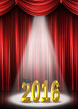 Gold graduation 2016 in spotlight on stage Royalty Free Stock Image