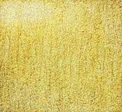 Gold grainy background Stock Photos