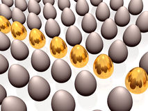 Gold and gray eggs Stock Images