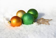 Christmas toys in the snow. royalty free stock image