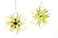 Gold and green glass Christmas hanging stars Royalty Free Stock Photo