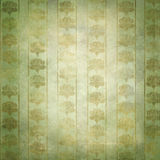 Gold and green grunge victorian wallpaper. A vintage wallpaper with grunge effects royalty free stock photos