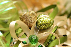 Gold and green heart with decorative bows Royalty Free Stock Image