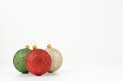 Gold, green and red Christmas balls Royalty Free Stock Photo