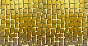 Gold grunge background with gold deformed metal grid Royalty Free Stock Image