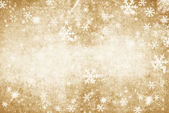 Gold grunge Illustration of a Winter Background with Snowflakes Stock Image