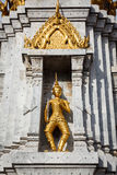 Gold guard on tower, Wat Phi, Thailand Stock Photo
