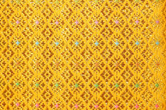 Gold guipure, embroidery on cloth texture Stock Images