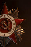 Gold hammer and sickle. On the Soviet award of Patriotic War royalty free stock images
