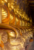 Gold hand Buddha statue sit. Faith light gold color hand thai art Buddha statue Stock Photography