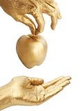 Gold hand giving apple Stock Images