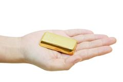Gold in a hand Stock Photography