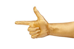Gold hand points a finger. Stock Photography