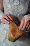Gold handbag in bride hands Stock Photo