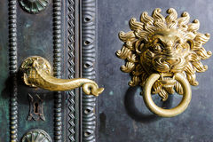 Gold handle and knocker with lion Royalty Free Stock Images