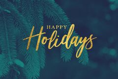 Gold Happy Holidays Christmas Calligraphy Script with Tree Evergreen Background