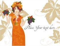 Gold Harvest. Girl decorated with leaves and berries on the white background with gold leaf Royalty Free Stock Photo