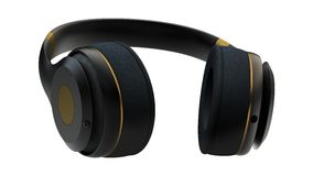 Gold headphones Royalty Free Stock Photography