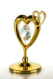 Gold heart. With a crystal on a white background stock photo