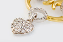 Gold  heart pendant with dimonds Stock Image
