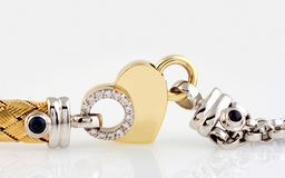 Gold heart with white diamonds royalty free stock photos