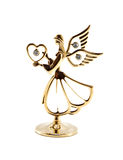 Gold heart. Is in the hands of angel stock photo