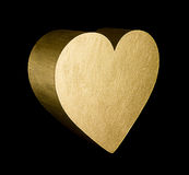 Gold heart. A solid gold heart on a black background stock photos