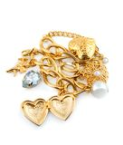 Gold heart. In necklace isolated on white background royalty free stock photography