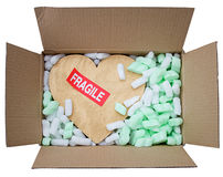 Gold heart in box with fragile sticker Royalty Free Stock Photos