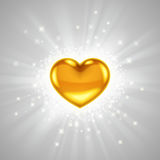 Gold heart with bright radiance Stock Images