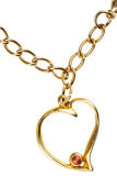 Gold heart on chain Royalty Free Stock Images