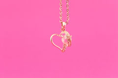 Gold heart on a chain Stock Image