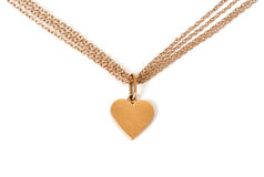 Gold heart on chain, isolated on white. Background royalty free stock photo