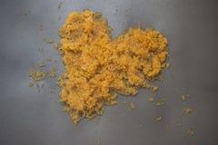 Gold Heart  decorative sand. Royalty Free Stock Photo