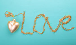 Gold heart with gold chain.  stock photography