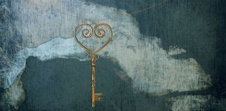 Composite image of gold heart key Royalty Free Stock Photo