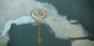 Composite image of gold heart key Royalty Free Stock Photography