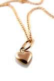 Gold heart pendant with chain. Rose Gold heart pendant with chain on white background royalty free stock photo