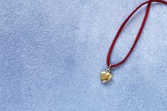 Gold heart pendant gift. For Valentine`s Day royalty free stock image