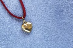 Gold heart pendant gift. For Valentine`s Day stock photos